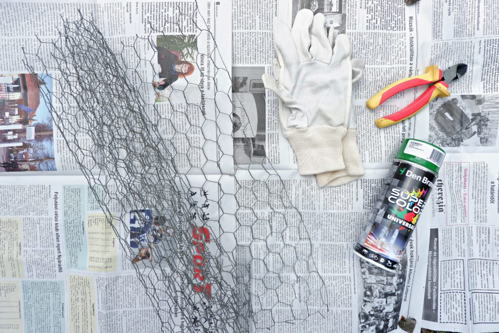 newspapers-with-chicken-wire-and-protective-gloves-wire-cutters-and-spray-paint
